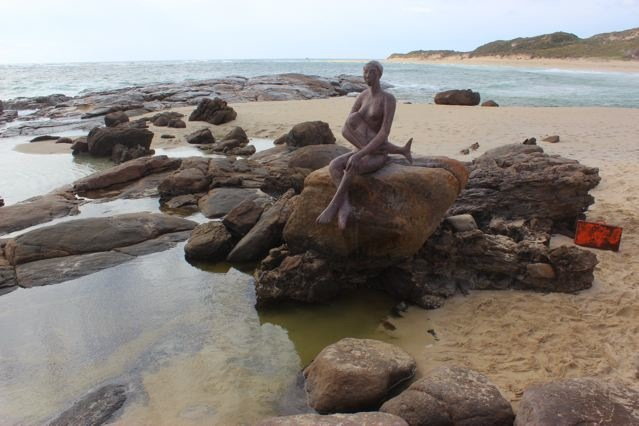 Layla breastfeeding at the mouth of the Margaret River by Russell Sheridan
